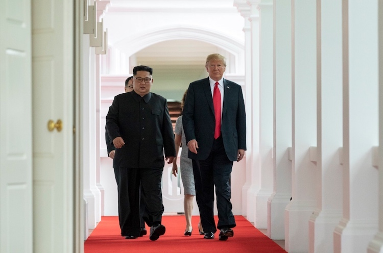 Photo: Kim and Trump walking to the summit room during the DPRK–USA Singapore Summit on June 12, 2018. Credit: Wikimedia Commons.