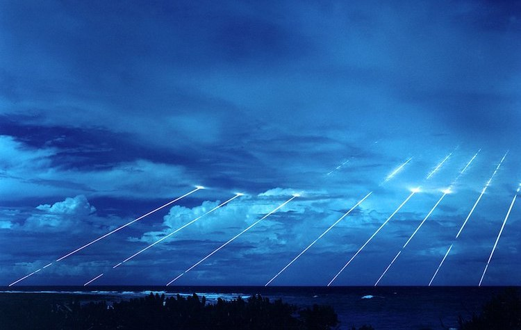 Photo: Testing of the Peacekeeper re-entry vehicles at the Kwajalein Atoll. All eight fired from only one missile. Each line, if its warhead were live, represents the potential explosive power of about 300 kilotons of TNT, about nineteen times larger than the detonation of the atomic bomb in Hiroshima. Credit: Wikimedia Commons.
