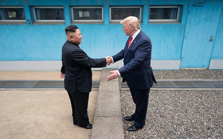 Photo: President Donald Trump shakes hands with North Korea's Kim Jong Un on 30 June 2019, as the two leaders meet at the Korean Demilitarized Zone. (Official White House Photo by Shealah Craighead)