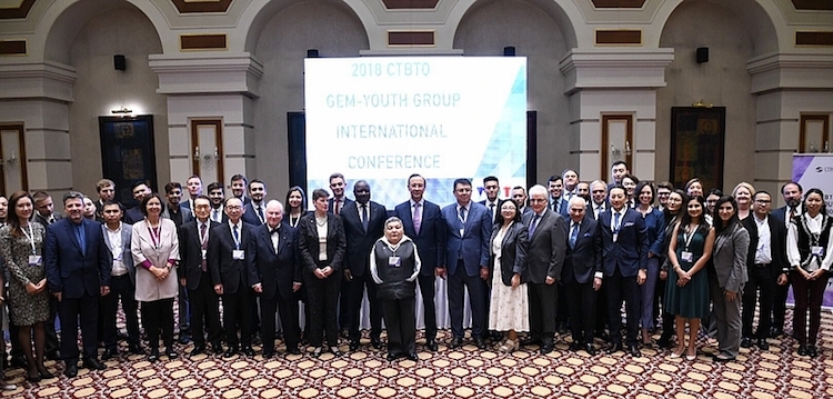 Photo: Participants of the 2018 CTBTO GEM – Youth International Conference in Astana. In the front is ATOM Project leader, Honorary Ambassador and artist Karipbek Kuyukov. Behind him: Kazakh Foreign Minister Kairat Abdrakhmanov (on the right) and CTBTO Executive Secretary Dr Lassina Zerbo (on the left). Credit: CTBTO.
