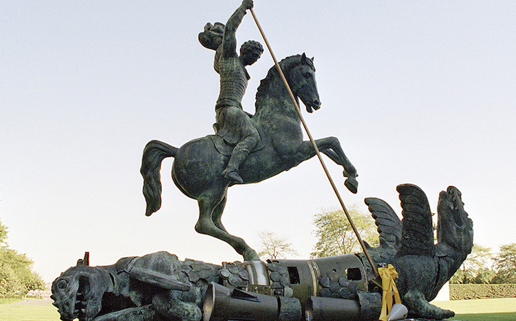Photo: Sculpture depicting St. George slaying the dragon. The dragon is created from fragments of Soviet SS-20 and United States Pershing nuclear missiles. UN Photo/Milton Grant.