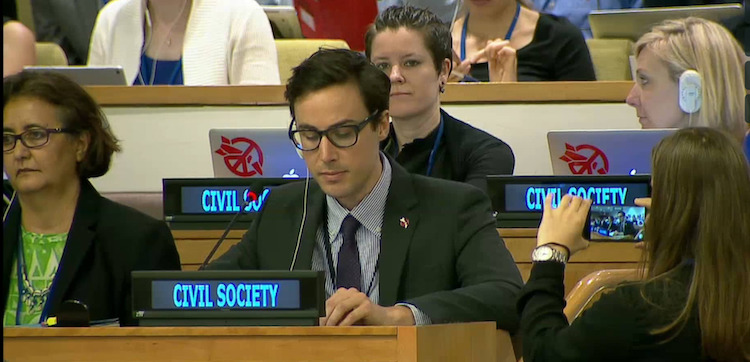 Photo: Tim Wright addressing the UN conference to ban nuclear weapons on behalf of ICAN on the second last day of negotiations on 6 July 2017. Credit: ICAN | Vimeo